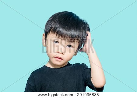 Young asian boy get confused and scratching his head confusing concept