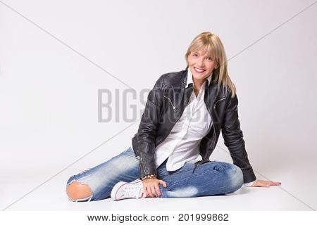Happy Smiling Mature Woman 40S Laying On Floor Casual Clothes