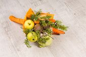 Eatable bouquet on wooden background. Composition of fuits and vegetables decorated with orange wrapping. poster