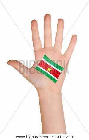 The Surinam flag painted on the palm.