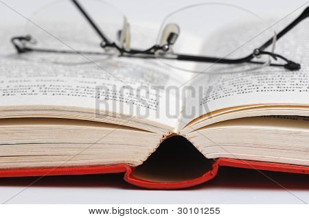 eyeglass on a open book