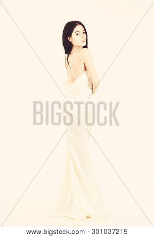 Bride, Graceful Girl In Dress. Fashion Model Demonstrate Expensive Fashionable Evening Dress Or Wedd