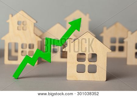 Up Arrow And Many Houses. Growth In Real Estate Prices Market. Buying And Selling House.