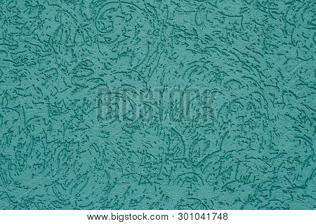 Abstract Pattern On Turquoise Wall Background. The Ribbed Blue-green Surface Of Concrete Wall. Cyan