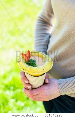 Woman Holding Healthy Vegan Street Food In Her Hands