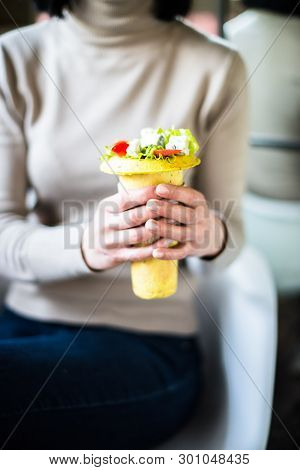 Woman Holding Healthy Salad In Her Hands