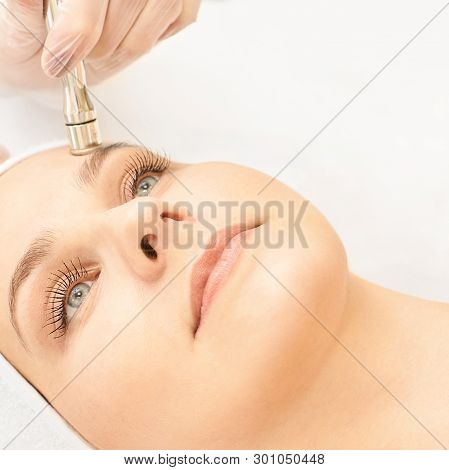 Electroporation facial rejuvenation. Cosmetology face treatment. Salon cosmetic hardware. Medical woman equipment. Beauty girl. poster