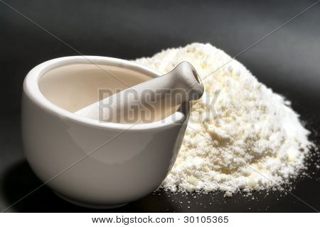 Mortar And Pestle With Fine White Medicine Powder