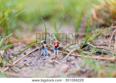 Miniature People : Traveler With Backpack Walking  In The Field