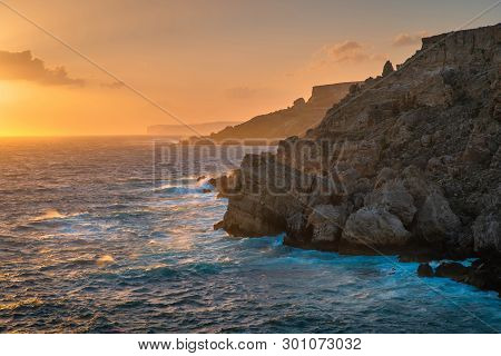 South Africa. Cape Town Coastline At Sunset. Rocky Seashore With Sea Mist Illuminated With Evening S