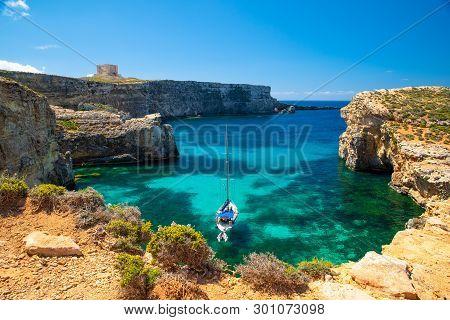 Malta Resort. Crystal Lagoon With Yacht. Malta Landscape. Comino Island. Summer Sunny Seascape. Malt
