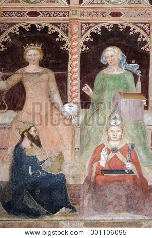 FLORENCE, ITALY - JANUARY 10, 2019: Civil Law-Justinian, Canonical Law-Clement V, Sacred Sciences and Liberal arts, detail of the Triumph of St. Thomas Aquinas,  Santa Maria Novella church in Florence