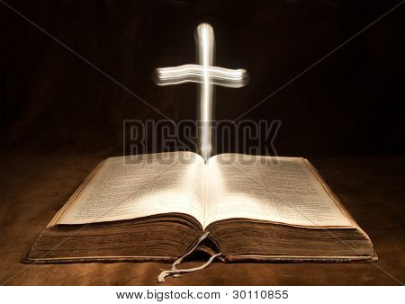 Opened Bible and Light Cross