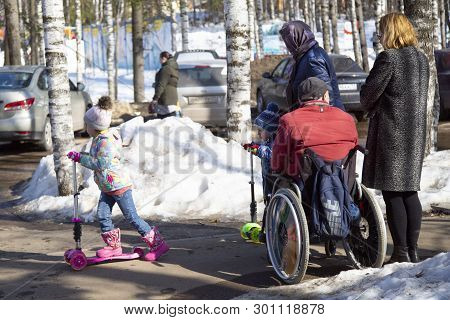 Syktyvkar, Komi/ Russia,april 7,2019/disabled Person In A Wheelchair Walking On The City Street.