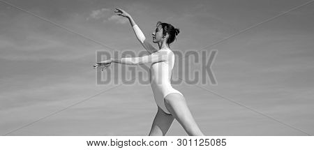 I Need To Practice More. Practicing Art Of Classical Ballet. Young Ballerina Dancing On Blue Sky. Cu