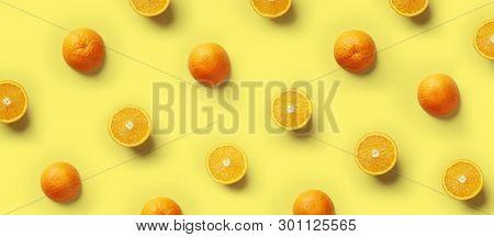 Fruit Pattern Of Fresh Orange Slices On Yellow Background. Copy Space. Pop Art Design, Creative Summ