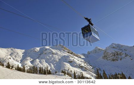 van aerial tramway to the blue sky background poster