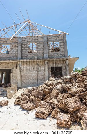 Construction Site Of Traditional Roof Thatching In Africa. Developing Of Traditional Tached Roof Civ
