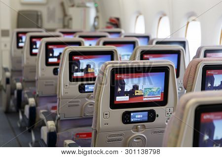 Dubai, Uae - March 20, 2015: Emirates New Economy Class Seats With Modern Multimedia System And Larg