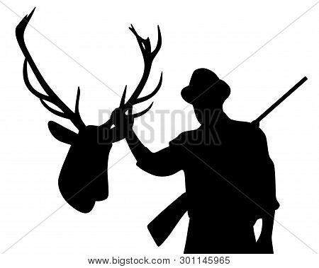 Hunter With Rifle Holding Stuffed Deer Head Hanging On A Wall As A Hunting Trophy