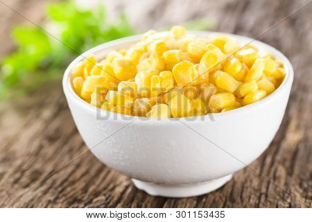 Frozen Sweet Corn Kernels In White Bowl, Parsley Leaves In The Back (selective Focus, Focus One Thir