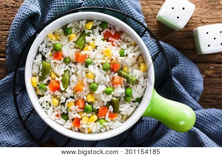 Cooked White Rice Mixed With Colorful Vegetables (onion, Carrot, Green Peas, Corn, Green Beans) In B