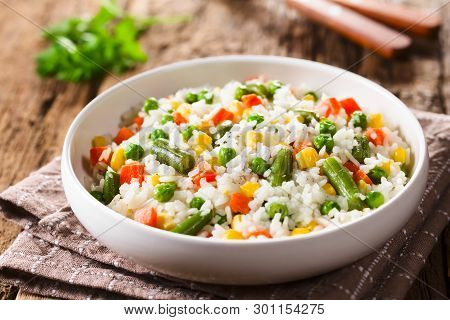 Cooked White Rice Mixed With Colorful Vegetables (onion, Carrot, Green Peas, Corn, Green Beans) In W