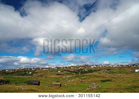 Country Landscape With Farmhouses Under Cloudy Sky In Torshavn, Denmark. Beautiful Landscape View. H