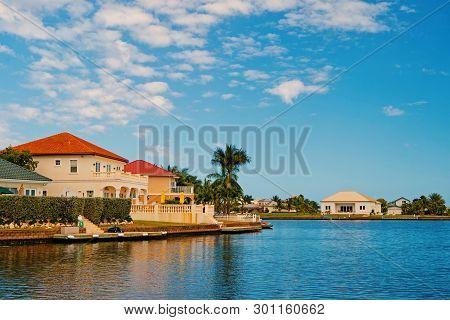 Summer Villa Of George Town, Cayman Islands. View On Summer Villa From Sea. Summer Villa Houses On B