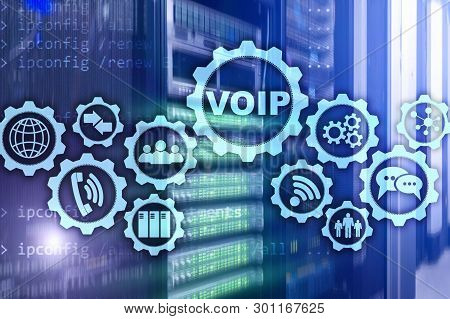 Voip Voice Over Ip On The Screen With A Blur Background Of The Server Room. The Concept Of Voice Ove