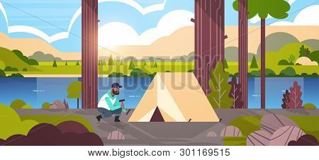 African American Man Hiker Camper Installing A Tent Preparing For Camping Hiking Concept Sunrise Lan