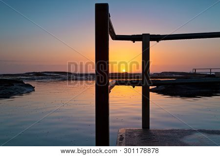 Glorious Tranquil Sunrise On The Ocean Horizon And Ocean Pool Ripples And Reflections. Location - No