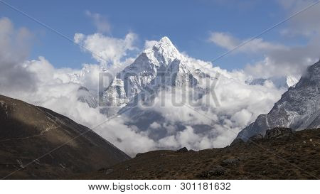 Ama Dablam Is A Mountain In The Himalaya Range Of Eastern Nepal. The Main Peak Is 6,812 Metres.ama D