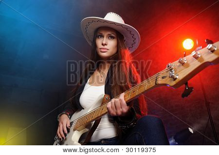 Young Beautiful Woman Playing The Guitar On The Scene