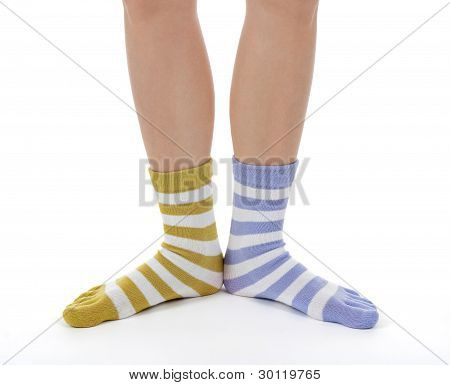 Funny Legs In Socks Of Different Colors