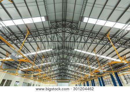 Steel Roof Truss In Car Repair Center, Steel Roof Frame Under Construction, The Interior Of A Big In
