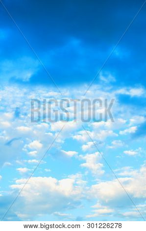 Blue dramatic sky background with colorful clouds, colorful vast sunset sky landscape. Picturesque sky landscape scene