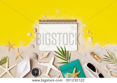 Clean Notebook With Accessories On Yellow Table Top View. Planning Summer Holidays, Travel And Vacat