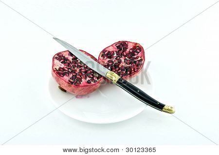 Pomegranate On Plate.