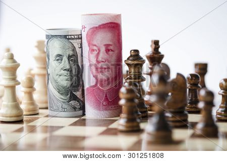 Us Dollar And Yuan Banknote With Chess For Tariff Trade War Between United States And China Which Bo