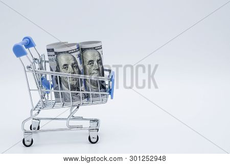 Closeup Shopping Cart With Us Dollar Banknote On White Background.united State Global Surplus Defici