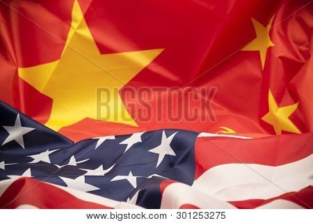 United States Of America Flag And Flag On White Background. Usa And China Trade Tariff War Concept.