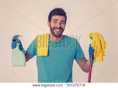 Breaking Gender Stereotypes. Portrait Of Attractive Happy Man Proud Holding Cleaning Equipment Ready