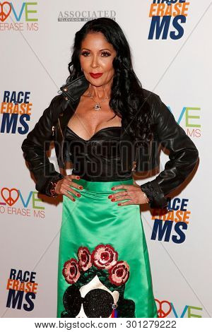 LOS ANGELES - MAY 10:  Apollonia Kotero at the Race to Erase MS Gala at the Beverly Hilton Hotel on May 10, 2019 in Beverly Hills, CA