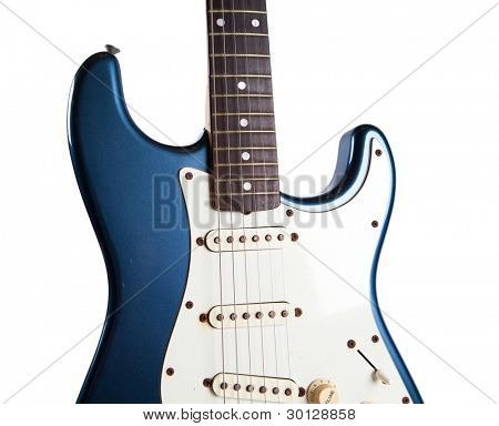 Real vintage metallic blue guitar with aged exterior, isolated on white.