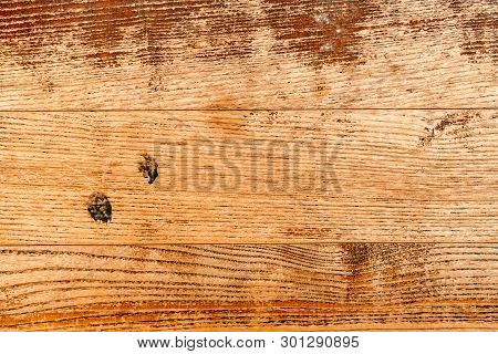 Rustic Worn Oak Wood Flooring Surface As Background. Weathered Wooden Material Pattern Texture.