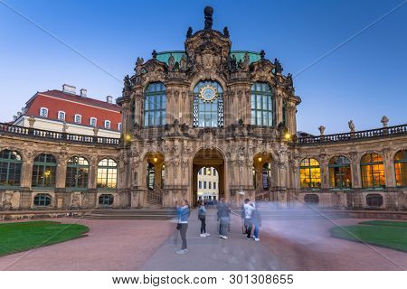 Dresden, Germany - April 19, 2019: Beautiful architecture of the Zwinger palace in Dresden ad dusk, Saxony. Germany