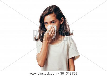 Sick Little Girl Blowing Her Nose And Covering It With Handkerchief