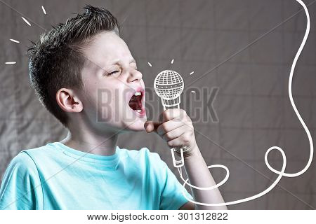 A Boy In A Blue T-shirt Sings Very Loudly Into A Painted Microphone