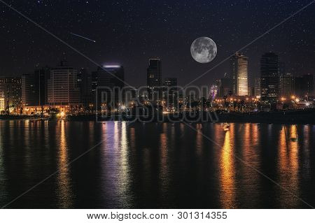 Full Moon And Stars In The Night Over Tel Aviv City, Israel